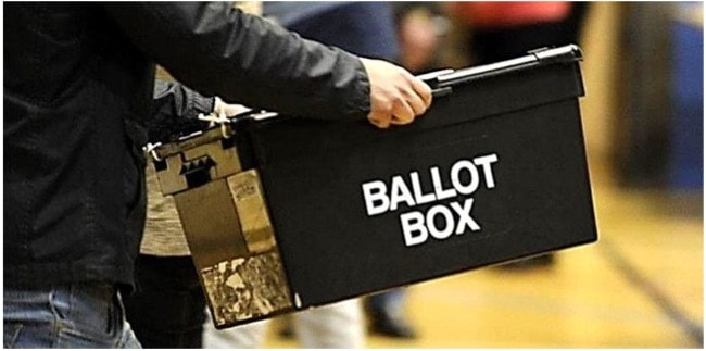 Man carrying a ballot box